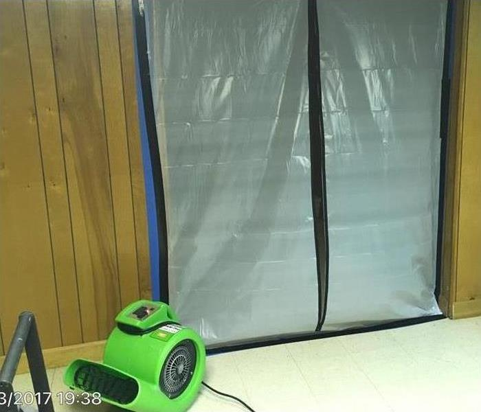 Mold containment in a building, plastic barrier for mold containment and drying equipment